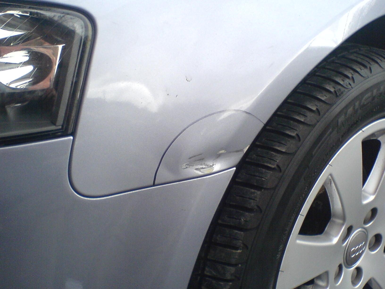 Car wing dent identified for insurance repair